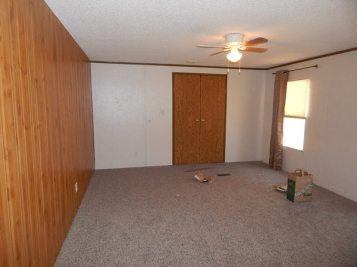 """Bedroom with new carpeting and """"wall"""""""