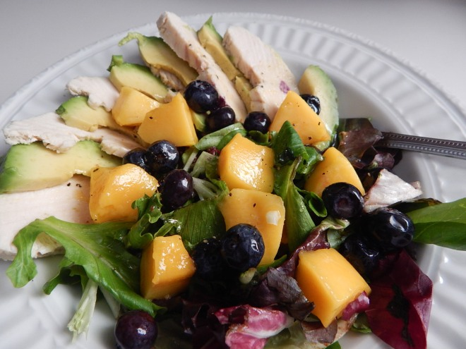 Poached chicken, avocado, mango, and blueberries with Spicy Maple Mustard Vinaigrette