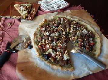 GF Sausage Pizza with Pesto, Pine Nuts, & Artichoke Hearts