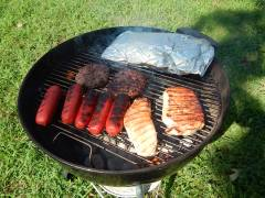 Pork chops, hamburgers, hot links & potatoes